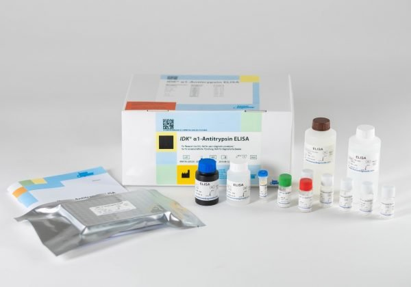 The components of Immundiagnostik's a1-Antitrypsin ELISA organized in front of a white background.